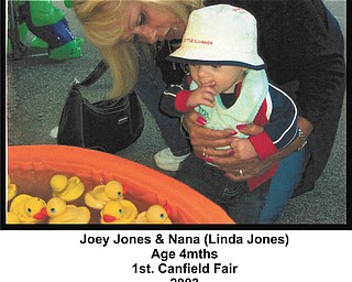 Joey Jones, 4 months, checks out a duck game with his Nana, Linda Jones of Youngstown. This was taken at Joey's first Canfield Fair, in 2003.