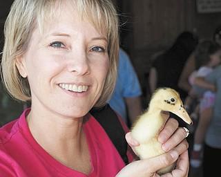 Karen Stroh of Bradenton, Fla., holds a duckling.
