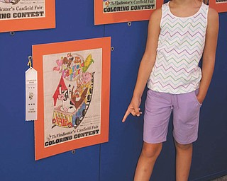 Hailey Kadivar of Bradenton, Fla., granddaughter of Bob and Joan Stroh of Poland, points out her 3rd-place finish in the coloring contest of 2009.