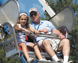 Hailey Kadivar of Bradenton, Fla., granddaughter of Bob and Joan Stroh of Poland, rides the Ferris wheel with her grandfather.