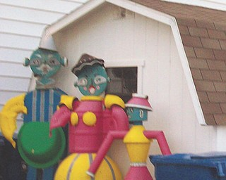 Another of Annette McCarthy's memories of the fair, a tin-man family.