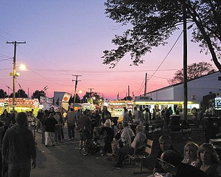 Crowds enjoy the Canfield Fair and the sunset during an evening in 2009. Photo submitted by John Simpkins.