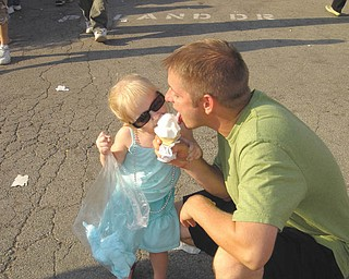 Patrick and MacKenzie Chrystal of Youngstown) share an ice cream cone.