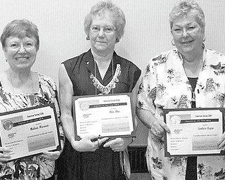 "Niles chapter sews up award: Jennie Roberts, center, accepted an award in August on behalf of the Niles Chapter of the American Sewing Guild at the national guild conference. The Niles chapter was named national ""Chapter of the Year"" for medium-size guilds. The award was given for outstanding performance by a chapter between 75 and 174 members in the areas of membership growth and development, service to members, outreach to retailers and community, publicity and information communication, and governance. Along with the national recognition, the Niles guild was awarded $1,000. Membership in the guild is open to all those interested in sewing."