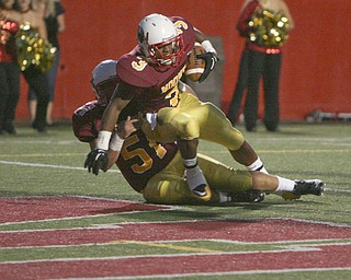 ROBERT K. YOSAY   THE VINDICATOR..Mooneys #3   Roosevelt Griffith  almost falls but is helped into the endzone by #51  Carmen Lanzo   as Mooney Scored its second touchdown - Boardman @ Mooney (YSU).-30