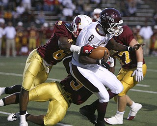 ROBERT K. YOSAY | THE VINDICATOR..CAUGHT FROM BEHIND -   Boardmans QB #8   Trae Robinson  is brought down by #6  Jarvis Abrams behind the line for a loss - Boardman @ Mooney (YSU).-30