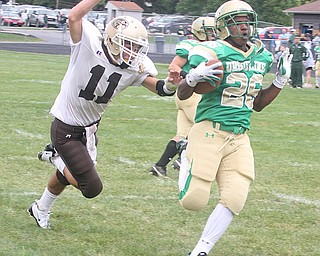 URSULINE - (26) Akise Teague just beats (11) Mike Yildiran into the end zone  Saturday afternoon. - Special to The Vindicator/Nick Mays