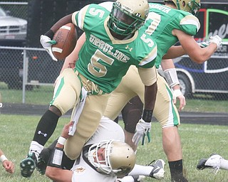 URSULINE - (5) Jesse Curry tries to get away from (5) Austin Vasko Saturday afternoon. - Special to The Vindicator/Nick Mays