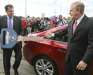 ROBERT K. YOSAY | THE VINDICATOR..GM North American Mark Reuss brings around the symbolic key to the first Cruze - ..-30-..