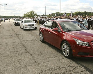ROBERT K. YOSAY | THE VINDICATOR..Flanked by the Boardmah Band - Cruze's Cruze by GM Lordstown  Kicked Off the Chevy Cruze today at the Lordstown Plant  with the President of GM - Tim Ryan - The Boardman Band and a slew of elected officials -..-30-..