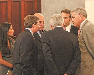 Defense lawyers in the Oakhill case huddle Thursday in court before joining prosecutors in a 90-minute meeting in chambers with Visiting Judge William H. Wolff Jr. of Kettering.