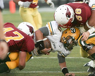 ROBERT K. YOSAY | THE VINDICATOR..CM  #47  Pat McGlone  and #58  Ryan Cook bring down #10 Kevin Burke  for St Eds at the line during the second quarter Cardinal Mooney vs St. Ed's  at Fitch Stadium..-30