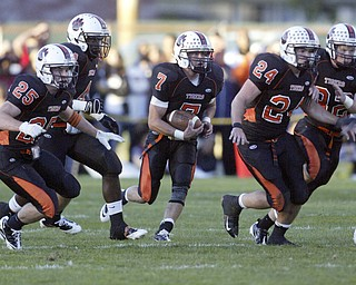 William D Lewis|The Vindicator Howland's Zac Wilson carries the ball during 1 rst qtr action Friday at Howland.