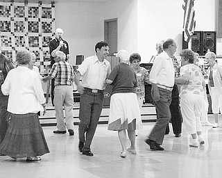 Niles SCOPE Senior Center of Trumbull County has resumed square dancing classes Tuesdays at the center, 14 E. State St., Niles. Learning the basic steps is easy. With Norm Flavell serving as caller and teaching the moves, this group of seniors gets into the swing of things during a recent class. The cost is $3 for each dance session. Interested senior citizens can sign up for the classes by calling 330-544-3676, or can just stop at the center on any Tuesday and join the group as it do-si-dos, circles four or promenades around the floor.
