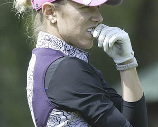 William D. Lewis| The Vindicator  Alexandra Casi studies the course at Greatest Golf Tourney Saturday.