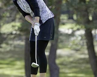 William D. Lewis| The Vindicator  Alexandra Casi makes a putt at Greatest Golf Tourney Saturday.