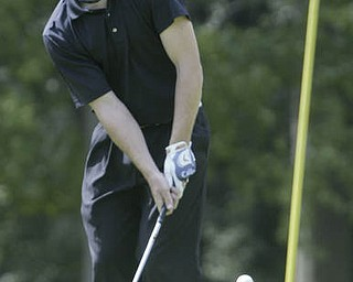 William D. Lewis| The Vindicator  Kyle Firm chips on #10 at Greatest Golf Tourney Saturday.