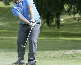 William D Lewis | The Vindicator  Josh Foster chips at TCC Sunday.