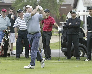 William D Lewis   The Vindicator  Gordon Price tees off as other golfers look on at TCC Sunday.