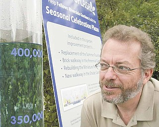 Keith Kaiser, above, Mill Creek Park horticulture director, looks at the fountain gauge in Fellows Riverside Gardens that is keeping track of fundraising to replace the Sommer Fountain.