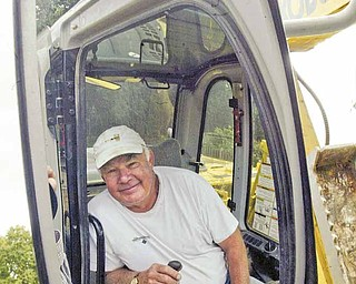 William D Lewis The Vindicator  Work underway for replacement of Sommers Fountain in MCP. Buzz Gubany, owner of Mrphy contracting who is doing work on hte project is reflected in hte mirror of an excavator atthe site.