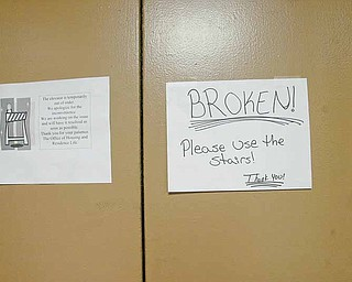 A sign on the elevator door at Kilcawley House dormitory at YSU cautions residents to take the stairs.