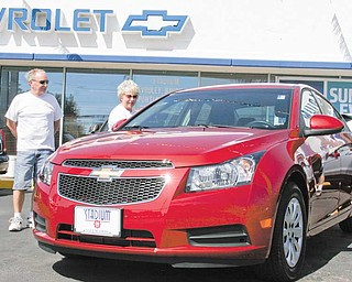 James and Ruth Cain of Salem check out a 2011 Chevrolet Cruze at Stadium GM Superstore in Salem on Wednesday. James Cain, a GM retiree, said he was impressed with the car.