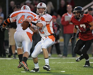 Howland QB Tim Parana passes from the pocket against Canfield during their game on Friday night.. Photo/Mark Stahl