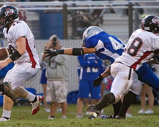 Geoffrey Hauschild The VIndicator.Salem's Trent Toothman (12) and Hubbard's ??? (44) during the second quarter of a match up between Salem and Hubbard at Hubbard Stadium on Friday evening.