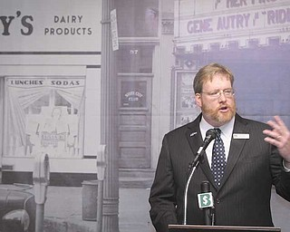 H. William Lawson, executive director of the Mahoning Valley Historical Society, discusses the progress of a fund-raising campaign to restore the three-story Harry Burt/Ross Radio building on West Federal Street, downtown Youngstown, to serve as the society's new headquarters.