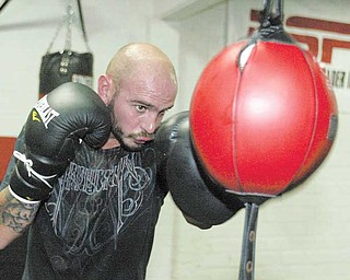 Kelly Pavlik trains on the double-end bag on Wednesday at the Southside Boxing Club.