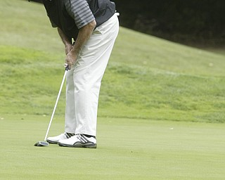 William d LEwis  The Vindicator Ed Antonelli winner of super senior golf tourney comes up short on a putt..