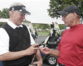 William D. Lewis the Vindicator Senior winner Bob Leonard , left, talks with runner up Kurt Beler after winning a 4 hole sudden death playoff.