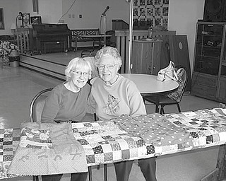 Craft show in Niles: The Niles S.C.O.P.E. Senior Center will sponsor a craft show from noon to 6 p.m. Sept. 28 at the center, 14 E. State Street. Tables are available for $10, and local crafters are welcome to participate. The show also will feature the Niles Art Class as well as the Monday Quilters Group. Above, Shirley Dull, left, and Evelyn Stillwagon work on a new quilt in preparation for the show. Proceeds from the event will go toward a new quilting frame for the group. For table reservations call 330-544-3676.