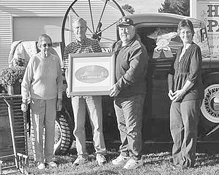 """'Junk in the Trunk' sale: The newly formed Winona Area Historical Society will sponsor its first fundraiser, a """"Junk in the Trunk"""" sale from 9 a.m. to 3 p.m. Oct. 9, rain or shine, at Hall Park, Whinnery Road. Among those preparing for the event with a trunk load of goods above are, from left, Myrtle Bailey; Robert Brandt, vice president; Derek Coffee, president; and Sheila Jackson, secretary/treasurer. Interested vendors can request a registration form by contacting the WAHS at wahsohio@gmail.com or by calling 330-222-1136 or 330-332-9606. The $20 fee reserves a vending spot for cars, trucks or vans with sellers providing their own tables and chairs. Food and refreshments will be available."""