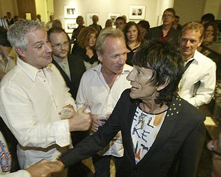 William D. Lewis The Vindicator Ronnie Wood shakes hands with visitors  at the Butler Museum of American Art Sept. 21, 2010.