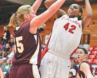 Youngstown State sophomore Brandi Brown takes a shot during a basketball game at the Beeghly Center. Brown is one of the key components in turning around the Penguins, who went 0-30 last season.