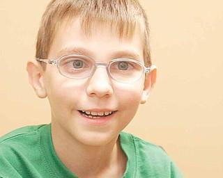 "Nicholai ""Kolya"" Denykin, 10, of the Renewal Orphanage in Dimitrov, Russia."