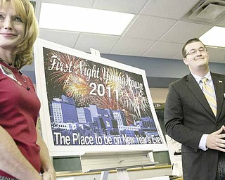 The 2011 First Night Youngstown button design takes center stage as it is unveiled by Elayne Bozick, who heads marketing and promotions for First Night Youngstown, and Kolt Codner, who created the design inspired by the city's downtown building landscape.