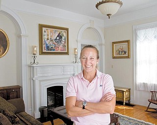 Becky Rudzik stands in her favorite room of her historic 1845 home. Rudzik, like many other homeowners in Poland, tries to maintain and preserve a historic home.