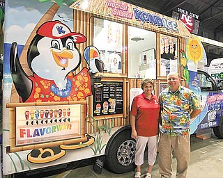 New business owners Renee and Tim Oswald show off their Kona Ice truck, which specializes in tropical shaved ice. The Oswalds joined more than a 100 other local businesses Thursday at the Youngstown/Warren Regional Chamber's 2010 Business Showcase.
