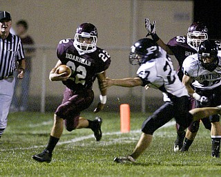 William D. Lewis  The Vindicator Allen Starkey of Boardman cuts downfield duriong Friday action at Boardman Team mate Carmen Tarantino  looks on past Perry defenders during 1 rst qtr action.