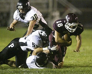 William D. Lewis  The Vindicator Nick bounavolonta of Boardman is brought down by a host Perry defenders during 1 rst qtr action Friday.