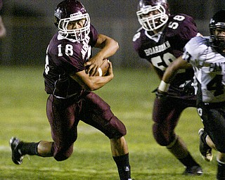 William D. Lewis  The Vindicator Nick Bounavolonta of Boardman carries the ball during 1 rst qtr action Friday.