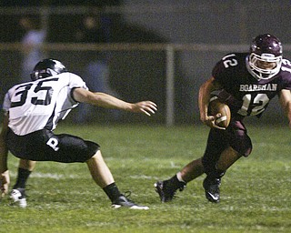 William D. Lewis  The Vindicator Tyler Walls of Boardman eludes Perry defenders during 1 rst qtr action Friday.