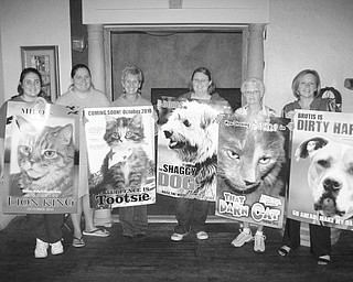 """Above are Megan Martini; Stephanie Lambert; Lora Herbert; Heather Jurina, manager of the Columbiana County Humane Society shelter; Sally Geary; and Lisa Shoff, all holding posters of adoptable pets, made to look as though they are movie stars for an upcoming """"red carpet"""" fundraiser."""