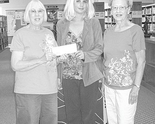 """We Love Libraries! From January through December monthly grants of $1,000 are being awarded by Sisters in Crime in conjunction with its """"We Love Libraries"""" lottery. In July, Newton Falls Public Library, 204 S. Canal St., Newton Falls, was the winner of the lottery. Taking part in the check presentation ceremony were, from left, Gloria Alden, a member of Sisters in Crime; Kerry Reed, library director; and Phyllis Mackey, mystery reader. The funds will be used to purchase books."""