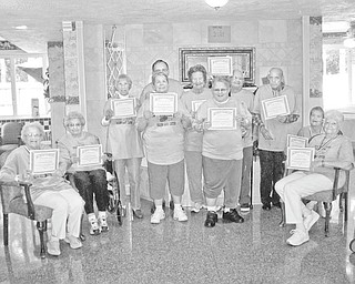 Winners in the Senior Games: Whispering Pines Village. 937 E. Park Ave., Columbiana, and Salem Care Center, 1985 E. Pershing St., Salem, sponsored the 2010 Senior Games on Sept. 16 at the Salem facility. Displaying certificates they received after participating in a series of activities such as bowling, cornhole, horseshoes and bingo, are, from left seated, Anna Mae Byers, Elizabeth Bell, Dora King and RuthAnne Garver, and standing, Rita Meandjia, Charlene Mudrick, Lee Mackall, Ferne Oliver, Lina Corman, Jim Henderson and Jerry Clunen.