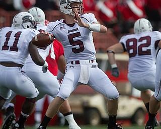 Geoffrey Hauschild|The Vindicator.Southern Illinois' Chris Dieker (5) throws a pass during the first quarter of a game at Youngstown State University's Stambaugh Stadium on Saturday afternoon.