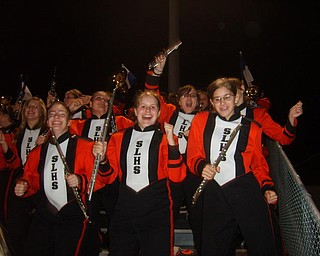 Members of the Springfield Local marching band have a blast as they dance at the Spingfield-Lisbon game.